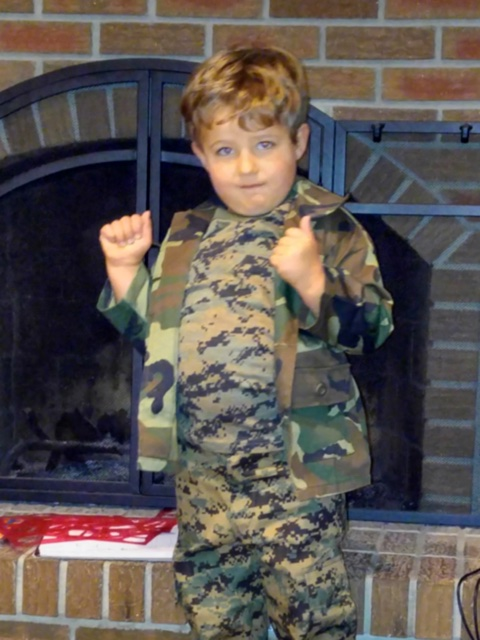 Happy customer sporting a complete set of kids'BDUs in camo