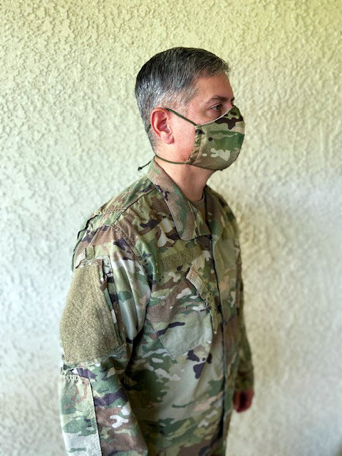 U.S. Army Soldier sporting camo face mask matching uniform